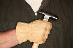 Man with Leather Construction Glove Holding Hammer Stock Image