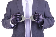Man in leather gloves holding handcuffs. Stock Photos