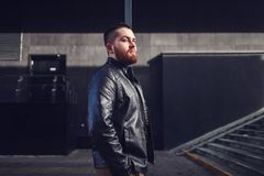 Man in a leather jacket. Cool man in a leather jacket posing in city Stock Photo