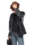 Man in leather jacket holding a guitar Royalty Free Stock Photo