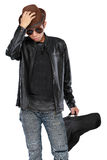 Man in leather jacket holding a guitar Stock Photography