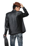 Man in leather jacket holding a guitar Royalty Free Stock Image