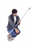 Man in leather jacket jumps with a broom Royalty Free Stock Photography