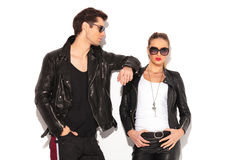 Man in leather jacket leaning elbow on girlfriend's shoulder Stock Image
