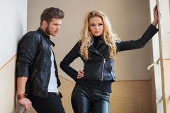 Man in leather jacket is lookin at his girlfriend Royalty Free Stock Images