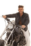 Man leather jacket on motorcycle sit happy Stock Photography
