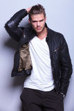 Man in leather jacket passing his hand thorugh his hair Royalty Free Stock Photos