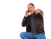 Man in leather jacket pointing at the camera Stock Photography