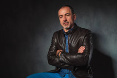 Man in leather jacket posing looking at the camera Stock Photography
