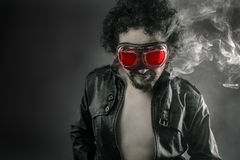 Man with leather jacket and smoke coming out of your body heat c Royalty Free Stock Photography