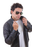 Man in a leather jacket with sunglasses Royalty Free Stock Photography