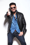 Man in leather jacket and sunglasses making the ok sign Royalty Free Stock Photos