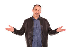 Man in leather jacket welcoming with both hands Royalty Free Stock Photos