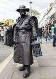 Man in leather mask. Llandudno, North Wales- 29th April 2017: Man in all leather fancy dress wearing leather mask, ,leather hat, carrying a lantern  at Llandudno Stock Photography