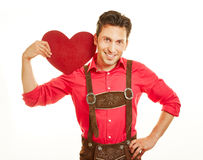 Man in leather pants holding red Stock Images