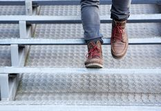 Man in leather shoes walking downstairs Royalty Free Stock Photos