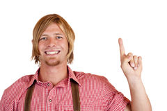 Man in leather trousers points with finger up Royalty Free Stock Photos