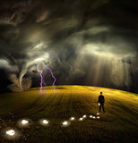 Man leaves trail of ideas. In stormy field Royalty Free Stock Photos
