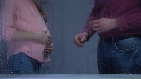 Man leaving engagement ring in front of pregnant wife, family problems, divorce. Stock footage stock footage