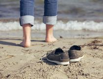 Man Leaving His Shoes Behind on the Sand Royalty Free Stock Image