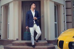 Man leaving a house. Rich man leaving a house stock image