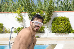 Man leaving the pool wearing dance party glasses Royalty Free Stock Images