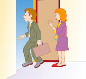 Man leaving for work. Woman waving at door her husband leaving for work Royalty Free Stock Image