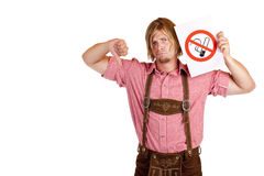 Man in lederhose disagrees to non-smoking-rule Royalty Free Stock Photography