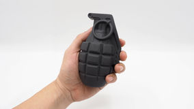 Man left hand and military bomb . Royalty Free Stock Photos