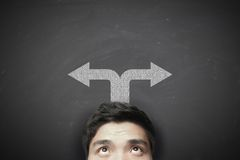 Man with left and right arrows Stock Photography