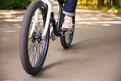 Man leg on bicycle pedal. Cropped portrait of man leg on bicycle pedal Stock Images