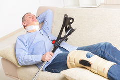 Man with leg in knee cages Royalty Free Stock Photography