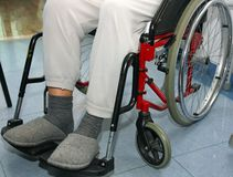 Man with leg problems over the wheelchairs Stock Images