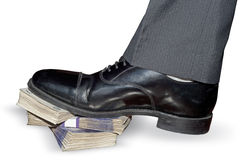 Man leg steps on money. Leg stepping on wads of banknotes (power concept Stock Photos
