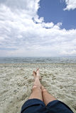 Man legs on beach Stock Photography