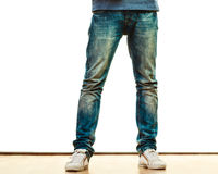 Man legs in denim trousers casual style. Fashion and teenager concept. Male legs in denim trousers casual style isolated on white background Stock Images