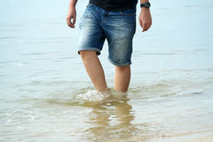 Man Legs Dip into Sea Water Royalty Free Stock Photography