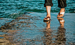 Man legs and feet  at the sea shore Royalty Free Stock Image