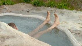 Man Legs In The Flowing Water. In calcium bath stock video footage