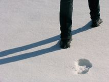 Man legs and footprints on the snow Stock Photo