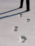 Man legs and footprints on the snow Stock Photography