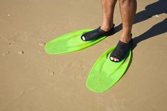 Man legs with green flippers Stock Photography