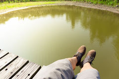 Man legs with lake Royalty Free Stock Image
