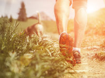 Man legs on the mountain footpath close up image Royalty Free Stock Images