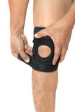 Man legs with one knee in a protective knee brace Royalty Free Stock Images