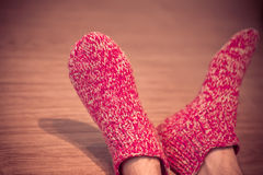 Man Legs in red Wool Socks male knitted clothes winter Stock Photos