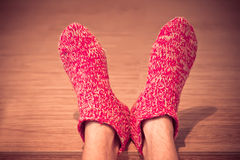 Man Legs in red Wool Socks male knitted clothes winter Stock Photography