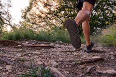 Man legs running on trail in the mountains royalty free stock photo