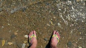 Man legs stand in sea water waves. Sea ocean holidays. Man legs stand in sea water waves. Sea the ocean holidays stock video