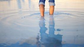 Man legs walks in the terrace water in Pamukkale. Man legs walks in the thermal terrace waters of Cotton Castle in Pamukkale Turkey stock video